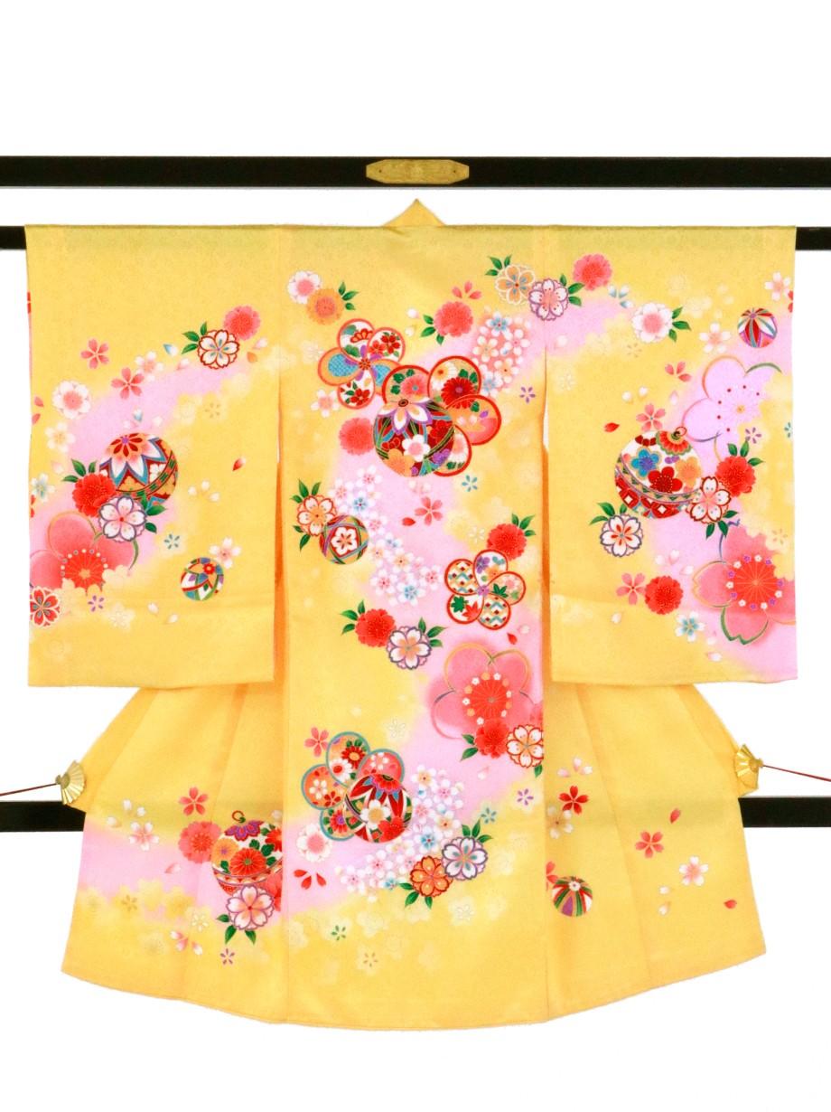 黄色地にねじり梅と手鞠と鈴の祝い着(産着)/女児