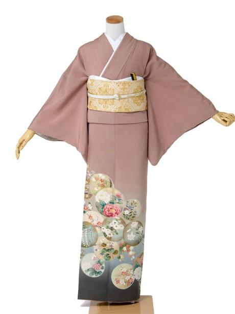 丸に四季花の色留袖